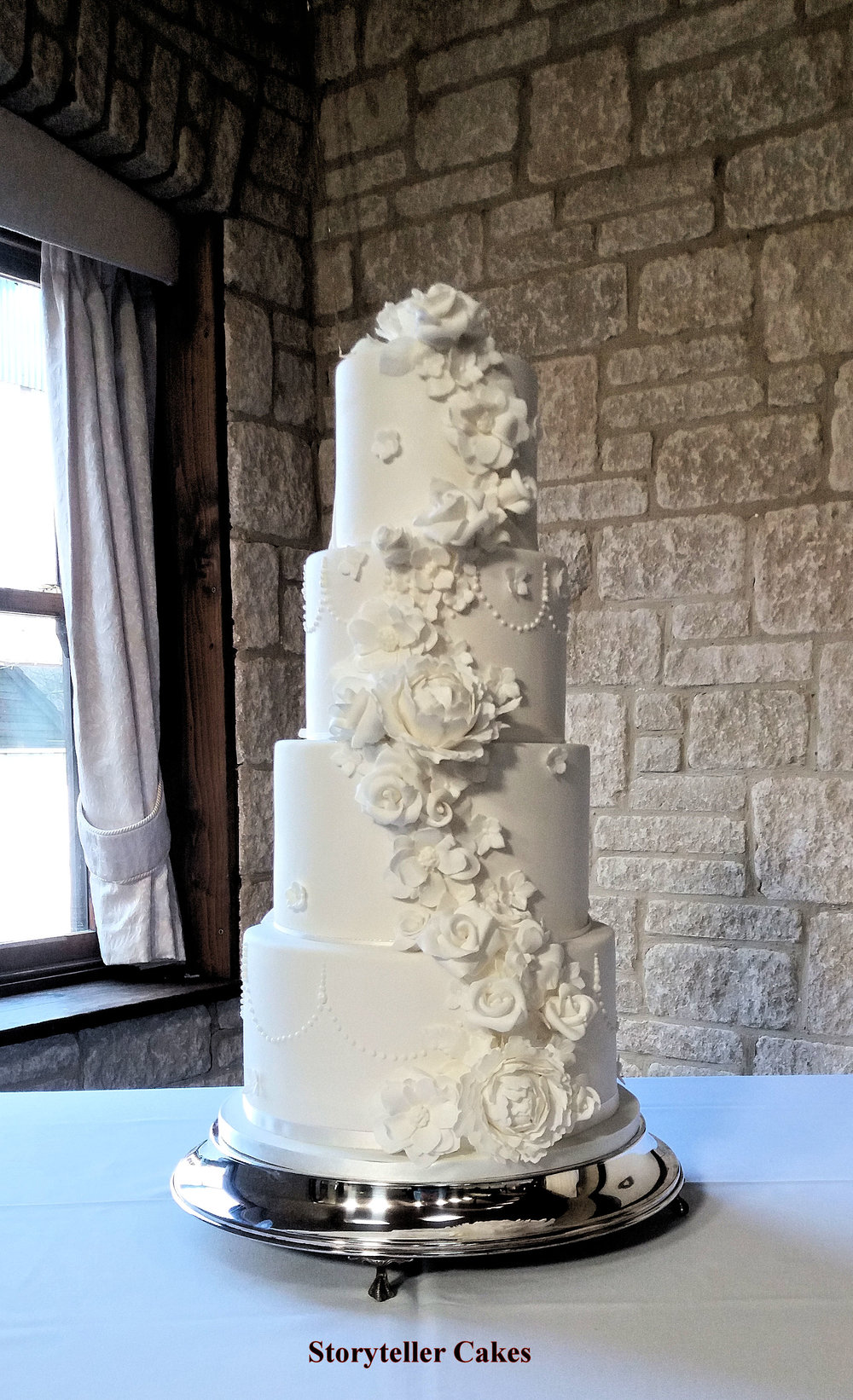 beautiful white floral half and half marvel wedding cake 6.jpg