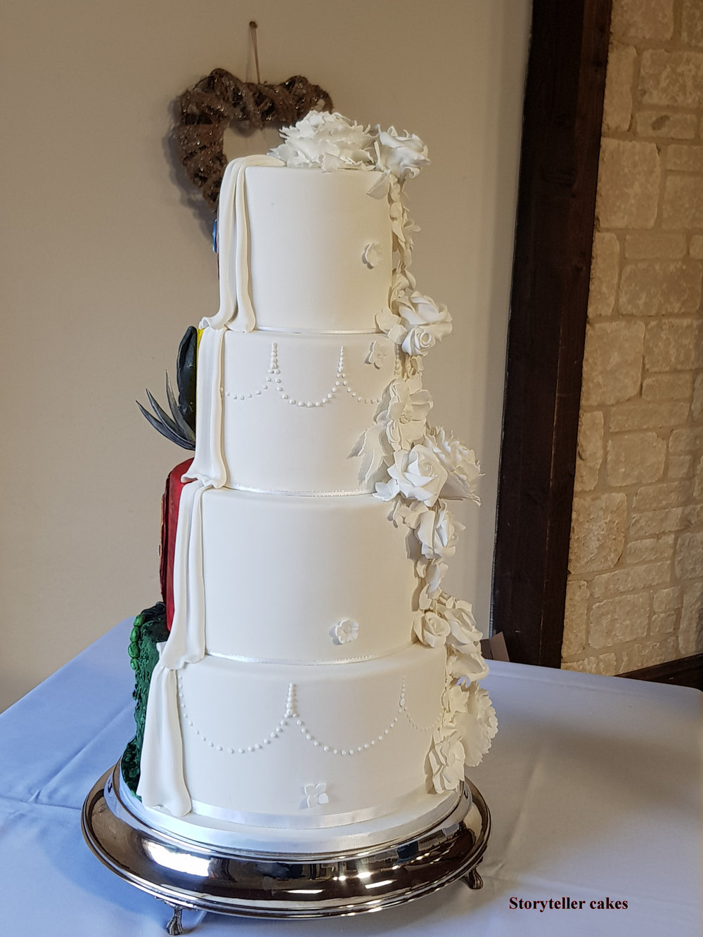 beautiful white floral half and half marvel wedding cake5.jpg