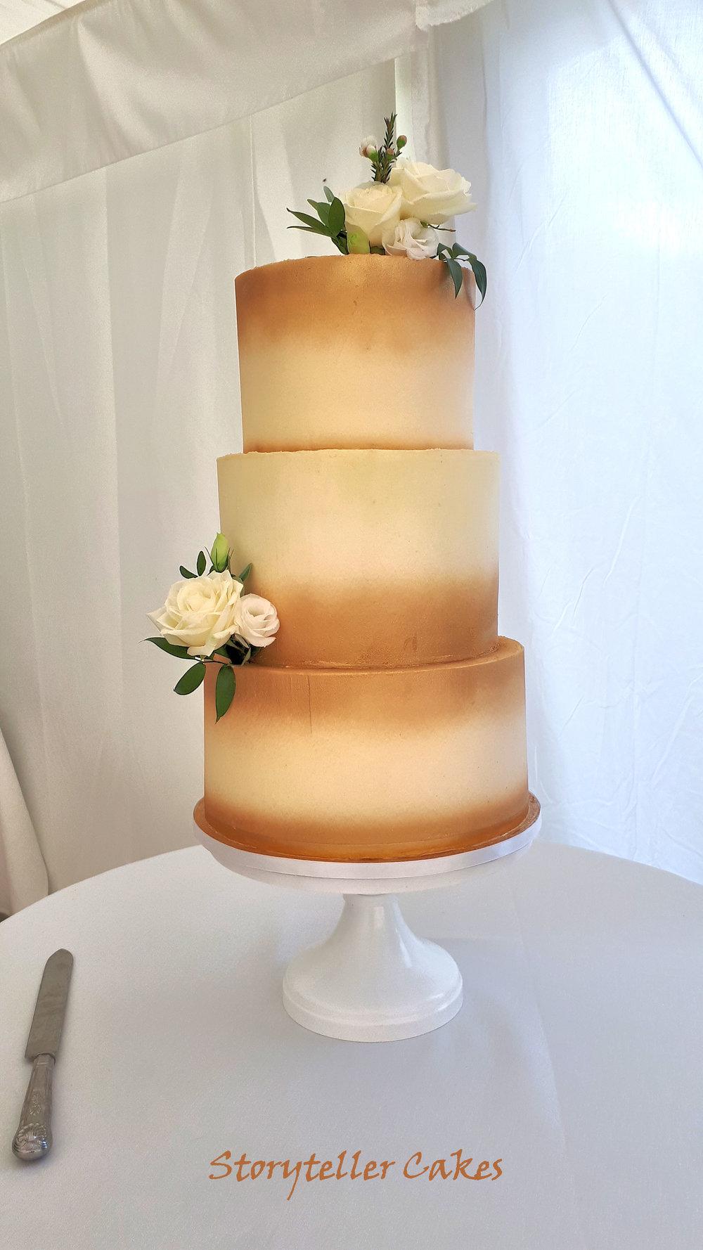 Gold and white buttercream rose wedding cake.jpg