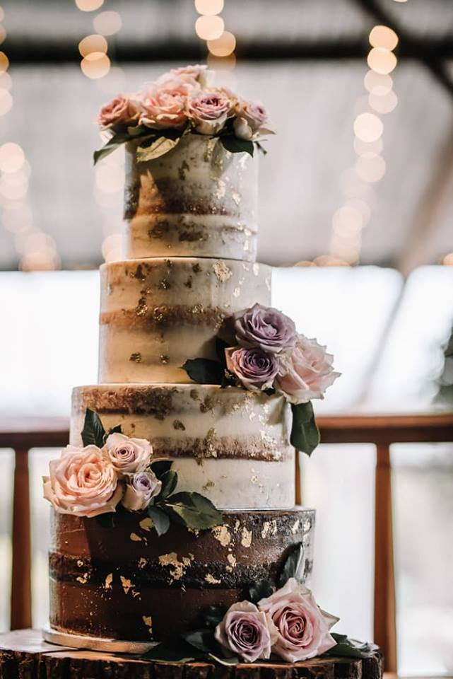 semi naked wedding cake with gold leaf and roses2.jpg