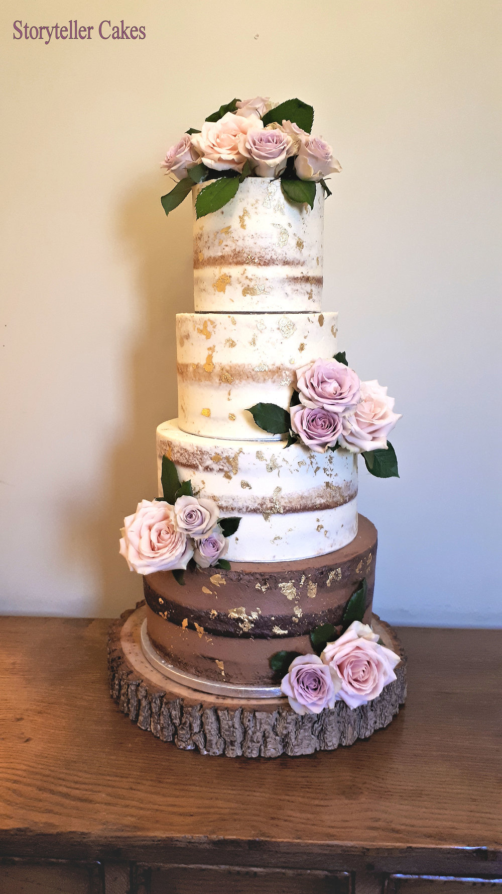 Semi-Naked Wedding Cake with Fresh Flowers and Edible Gold.jpg