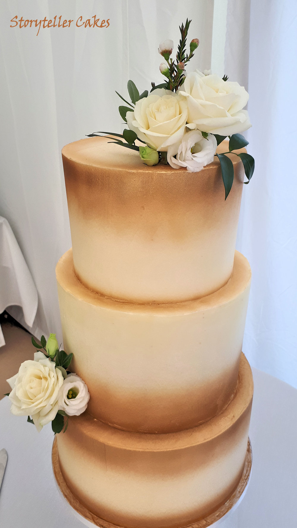 Gold and white buttercream rose wedding cake2.jpg