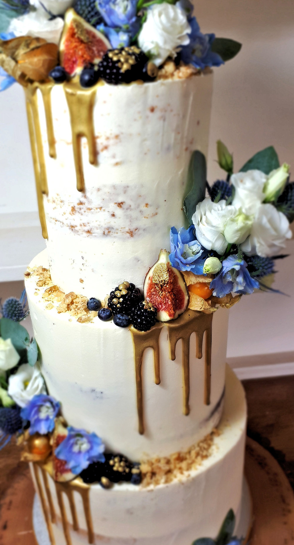 Semi Naked Wedding Cake with Blue and gold thisltes and fruit2.jpg