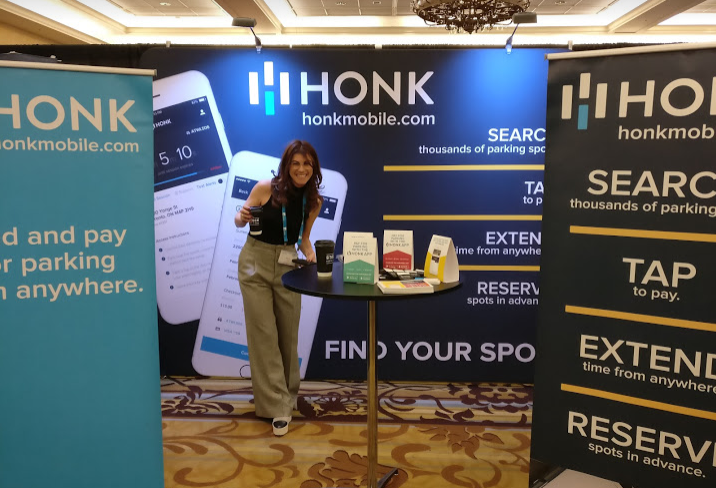 Pictured: Kacey rep'ing our Honk booth on the conference tradeshow floor.