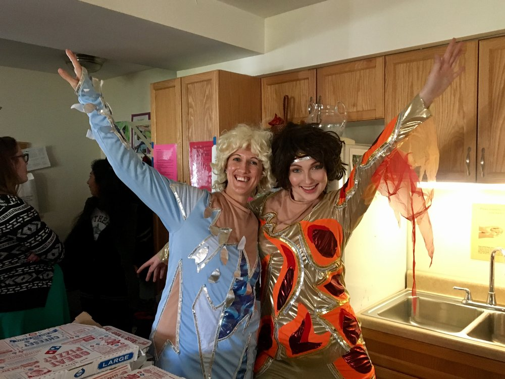 "Impact's Clinical Manager, Kristin Johanns, (left) and Development Coordinator, Emily Young, (right) strike a pose as the stars of ""Blades of Glory."""