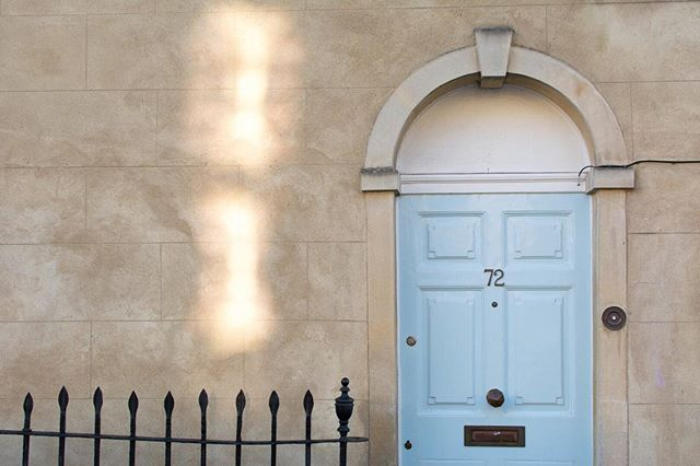A hint of sunlight warming the pastel tones on this house, sunshine makes everything better. ☀️ #bristoldoors
