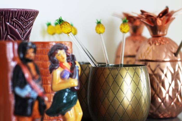 Pineapple stirrers make the drinks feel festive.