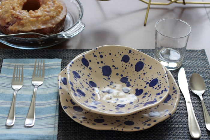 The plates and bowls are Ikea, and with varying shades and patterns of blues in the napkins and placemats, we brought some color to the dining space to pop against the wood tones.