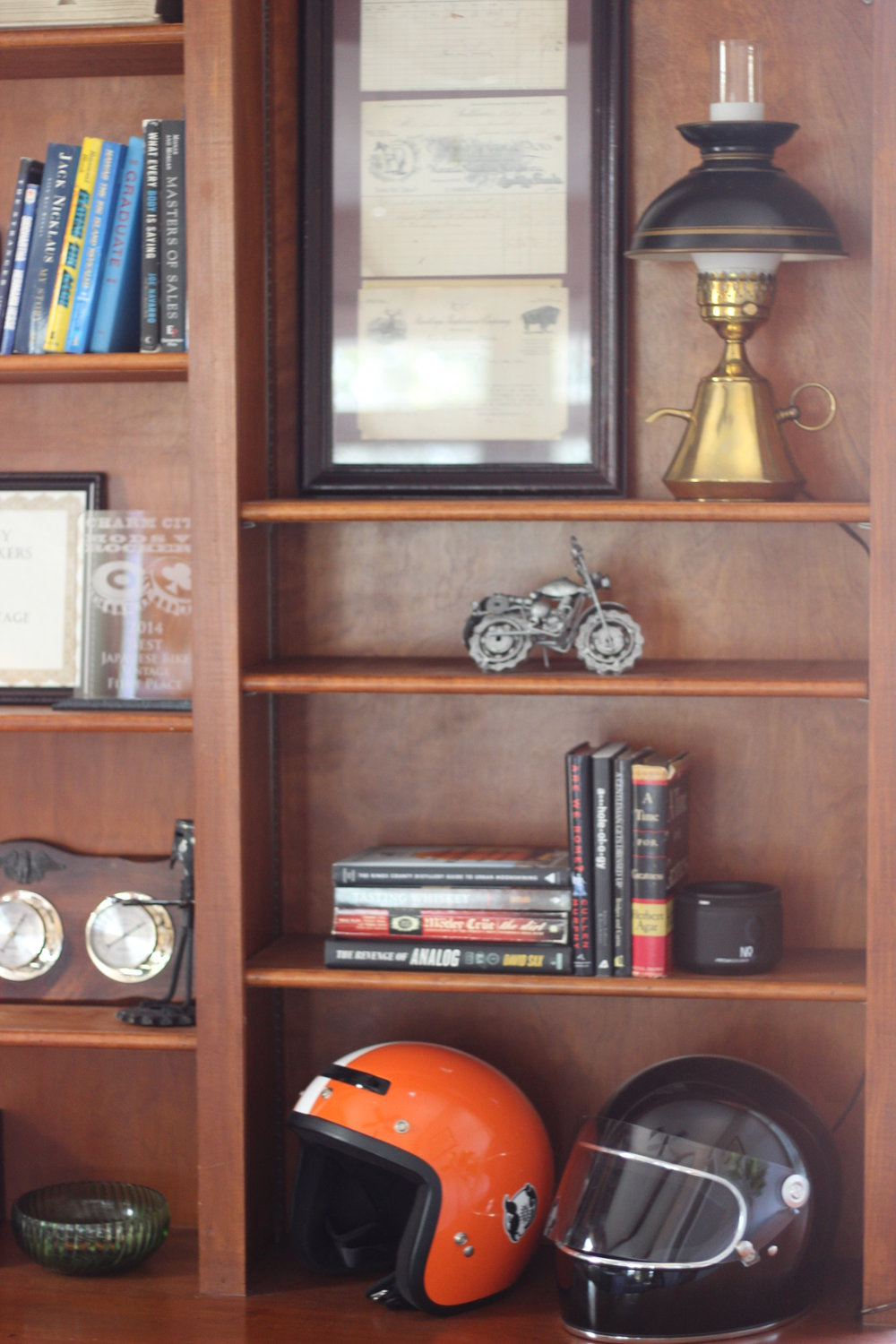 The client is also an avid motorcycle rider, so a few shelves had to house the gear.