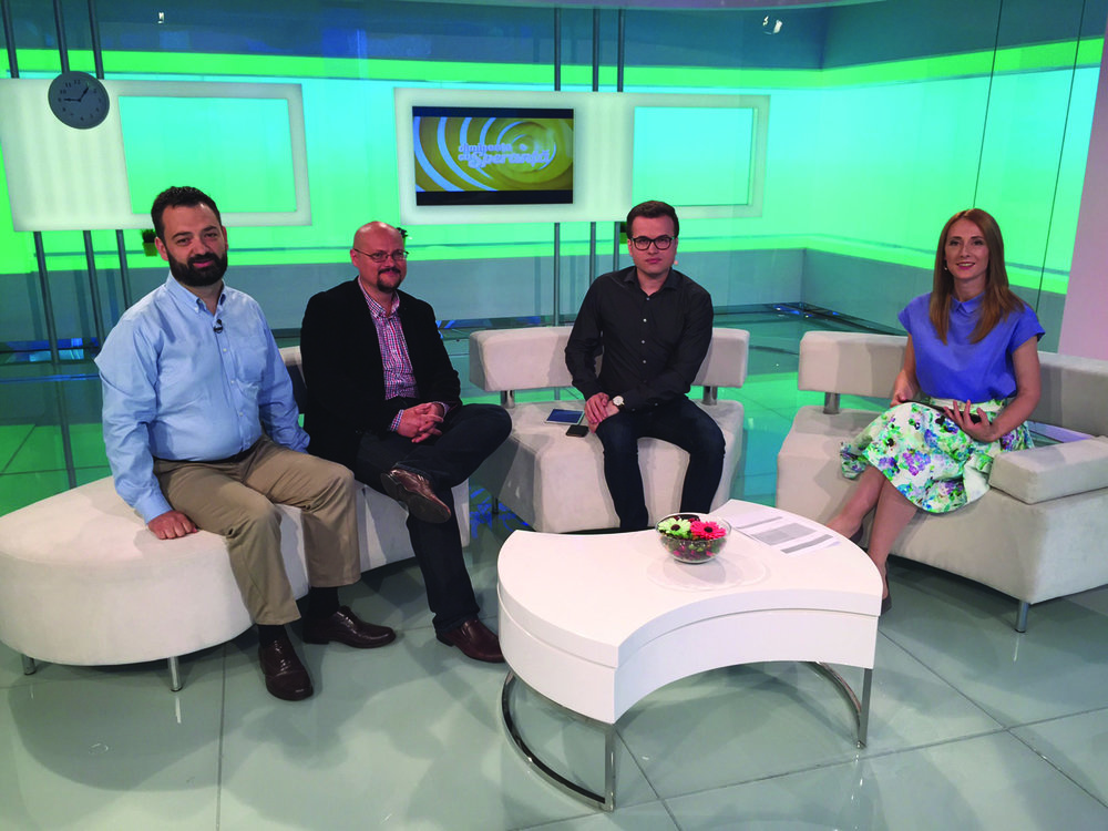 Alex Ilie (left) with Liviu Mihaileanu (center left), discussing the Romania Without Orphans movement on Romanian television.