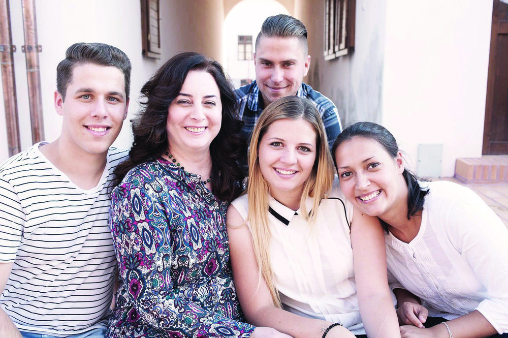 NOW:  Corina with her four children in 2017
