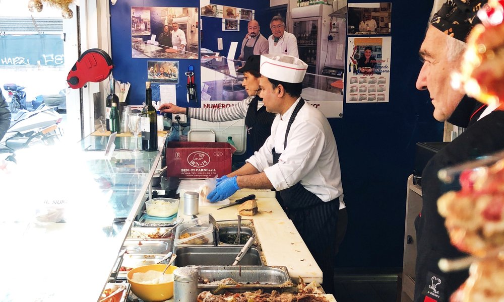 Sergio Esposito (r) and team making Roman recipe sandwiches at  Mordi e Vai , Testaccio Market.  Quartiere: Testaccio.