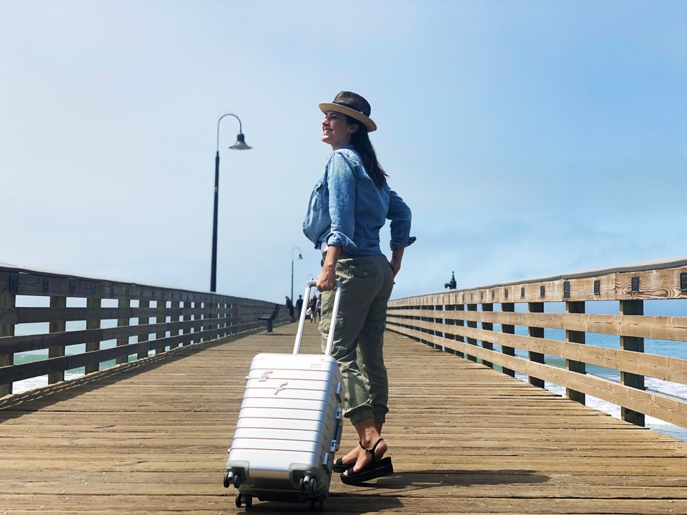 The Bigger Carry-On, Aluminum edition and me on the Cayucos pier.