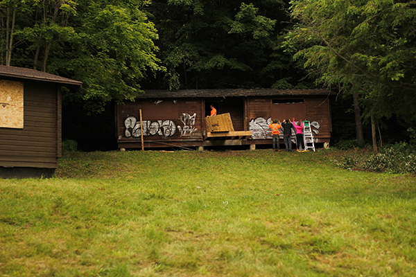 Students work together to restore an old cabin. (Photo: Bolton Camp)