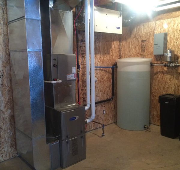 A mechanical room with forced-air furnace (left), ERV (top), and greywater system (right). Stay tuned for more info on greywater!