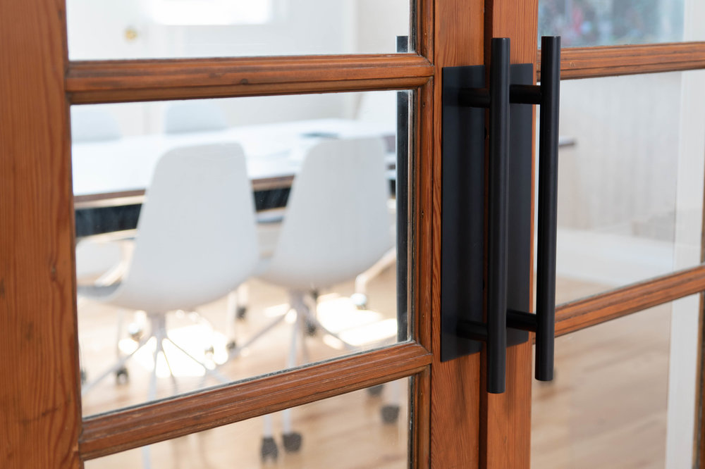 RepurposedBoardroom Doors - Salvaged from an early school renovation, these doors have travelled to Paul Dowsett's home, our previous office, and now finally resting in our current office – after being relocated twice. Did we mention they're still going strong?
