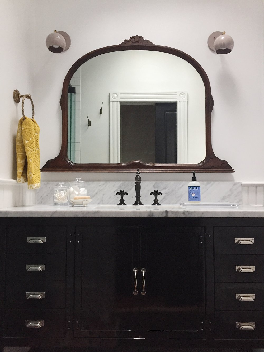 Details shown are from Anthropologie and Crate & Barrel. The black metal vanity is from Restoration and the mirror was an eBay find!