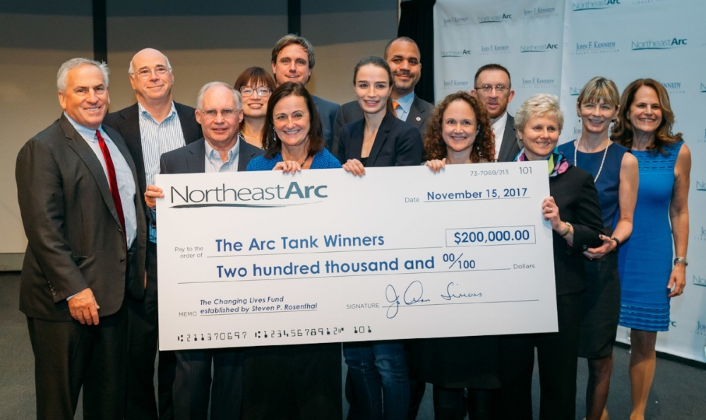 Steven P. Rosenthal of the  Changing Lives Fund  and JoAnn Simmons from  Northeast Arc  with the judges and the winners of the first  Arc Tank. Photo by Sean Goss