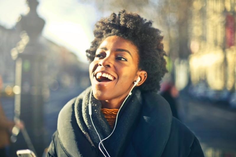 Note: This is not me. This is a representation of how I feel inside, as expressed by a woman of color, who here is seen experiencing joy. Normal in regular life, rare in stock photography.