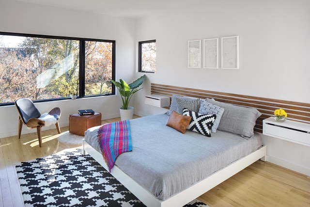 I think it's fun to pair funky patterns together into a complimentary palette! Here's a shot of my master bedroom that was used in the January Home of the Month feature in Indianapolis Monthly. Floating nightstands/duvet/plaid blanket/leather ottoman are from CB2, white platform bed from West Elm, black and white pillows from Ikea, rug from All Modern! @indymonthly @cb2 @westelm @westelmindianapolis @allmodern #mod_abode 📸 Tony Valainis #modern #moderninteriors #interiordesign #architecture #modernarchitecture #hotm