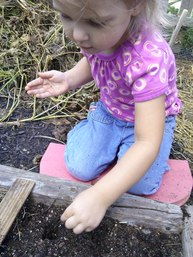 becky planting spinach seeds.jpg
