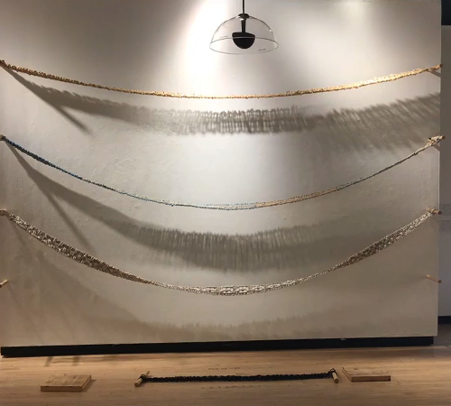 "Taking up Space 2018 hand-woven girdles of rope (sisle, poly, cotton, bungee), wood, sound D: 144"" x 96"" x 48"""