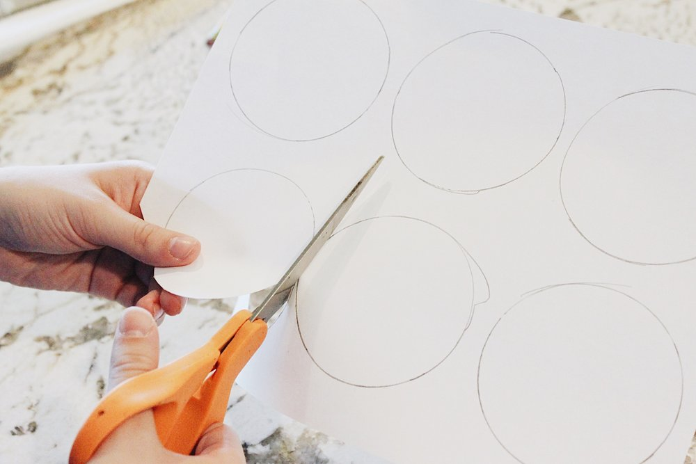 To make the white circles, trace circles onto white paper or felt. Hot glue or tape onto a black shirt.