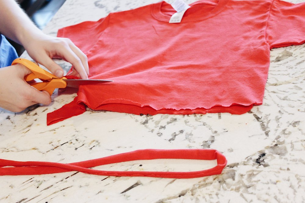 To make the red fabric strips, cut up an old red shirt into long strips and tie around arms, waist, and head.