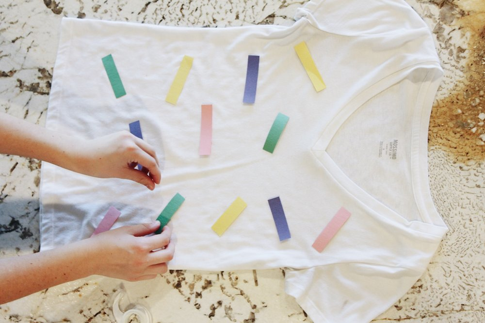 To make the ice cream shirt, cut up pieces of construction paper and tape or hot glue onto a white shirt.
