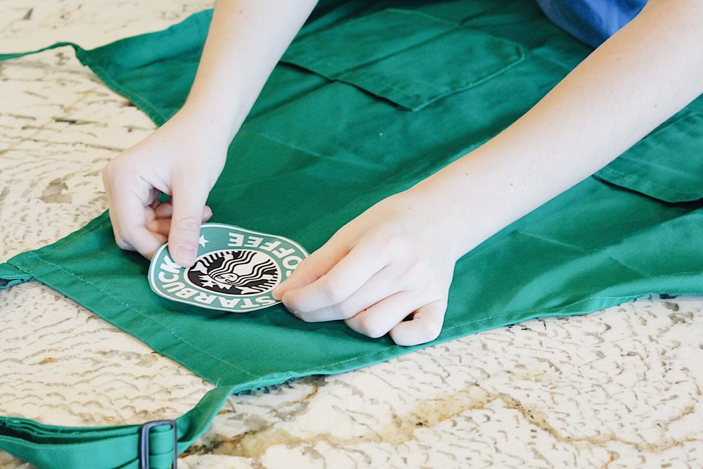 To make the apron, print out a Starbucks logo and tape it on.
