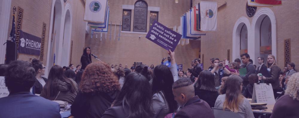Nathalie Amazan demands a #DebtFreeFuture at Public Higher Ed Advocacy Day 2018. (Jen Ford/PHENOM)