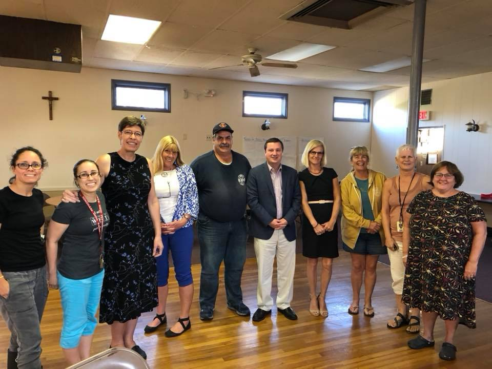 South Shore Education Justice Alliance members discussing overheated schools and safety concerns with State Rep. Joan Meschino in September.