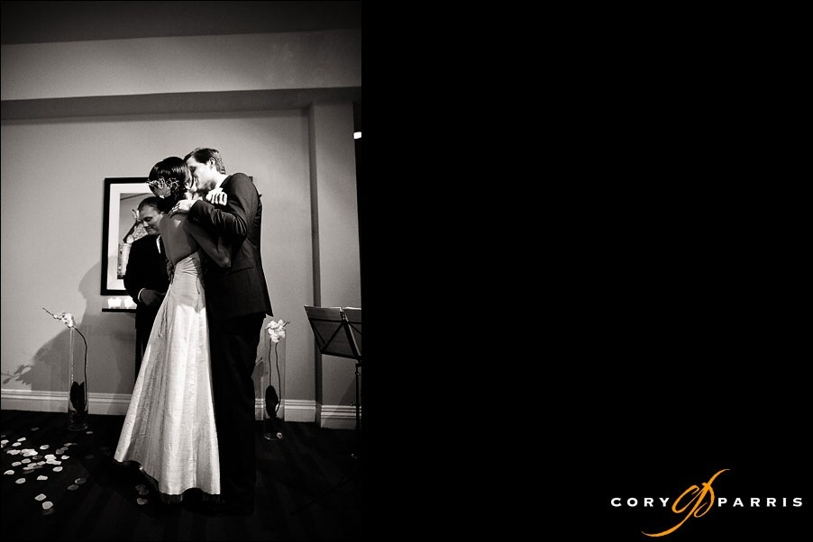 bride and groom kissing during wedding ceremony by seattle wedding photographer cory parris