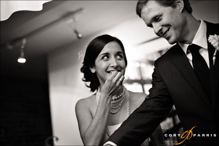 bride and groom laughing as they eat after their wedding at the alexis hotel in seattle