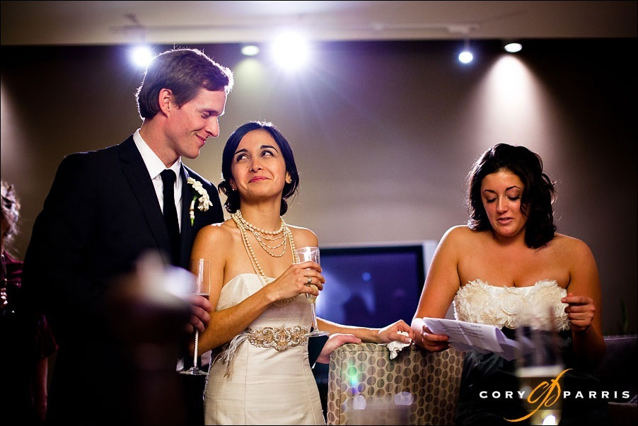 bride and groom looking at each other during a toast by seattle wedding photographer cory parris