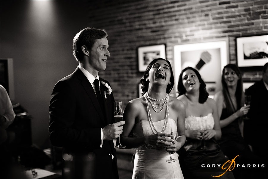 bride and groom laughing during toasts by seattle wedding photographer cory parris