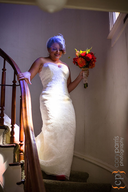 bride walking down the stairs at the beacon hill garden house