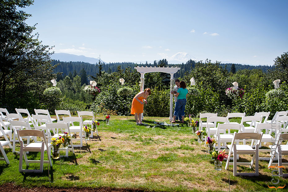 Setting up for a backyard wedding in front of Mt. Ranier