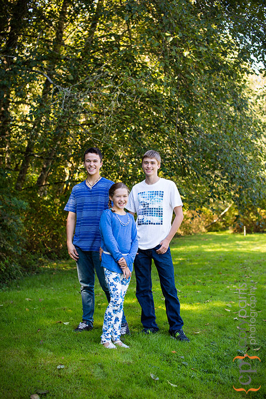 portrait of three kids in the woods