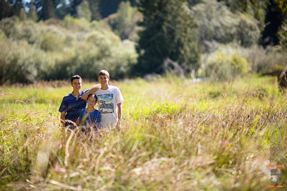 three kids in a field