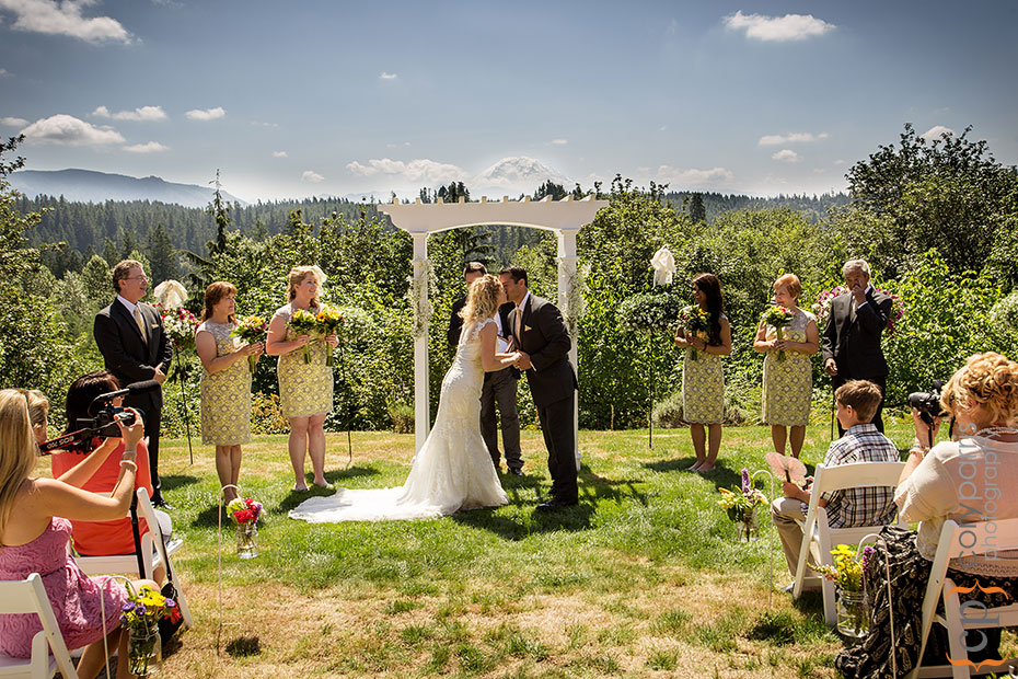 bride and groom first kiss with view of Mt. Ranier