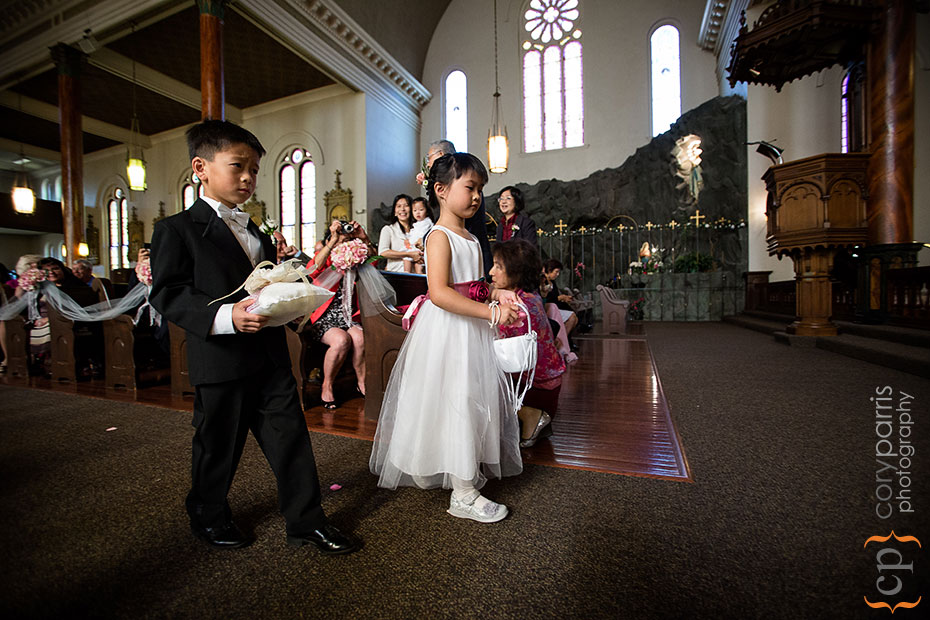 flower girl and ring bearer walking down the aisle