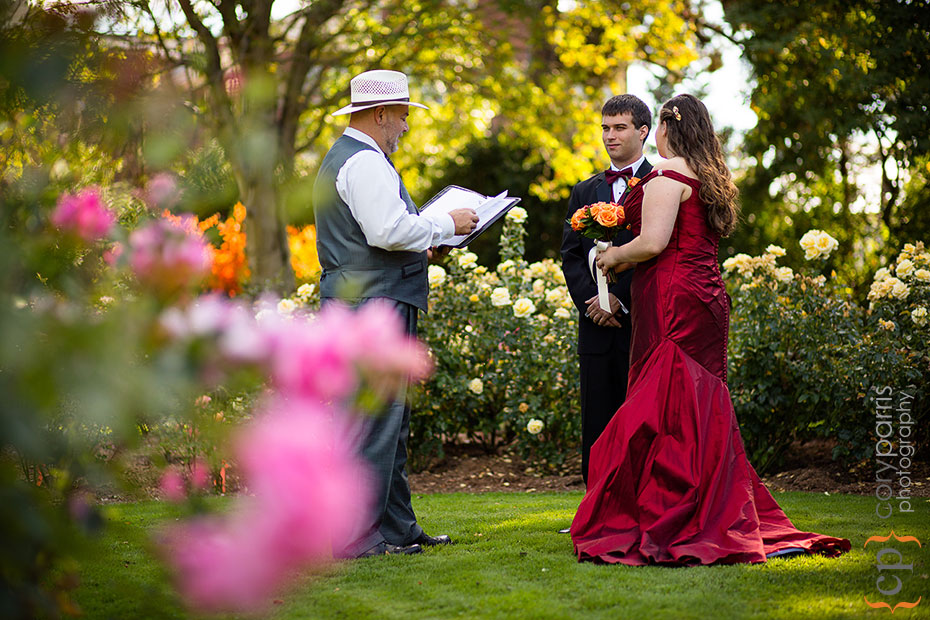 bride and groom getting married in the woodland park rose garden