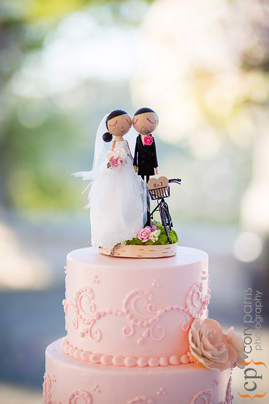 wedding cake topper with cute couple and bike