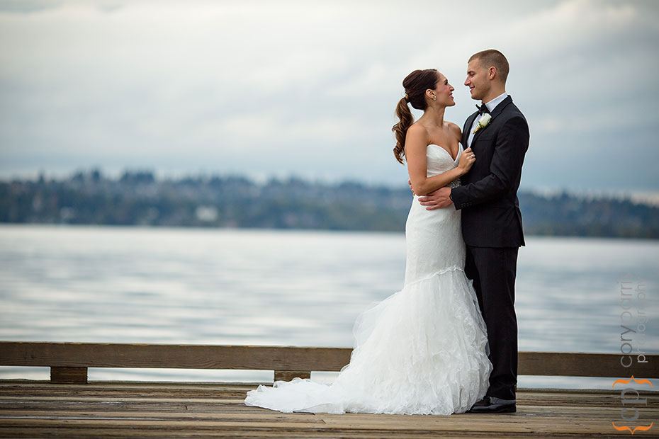 bride and groom on a dock by Woodmark Hotel