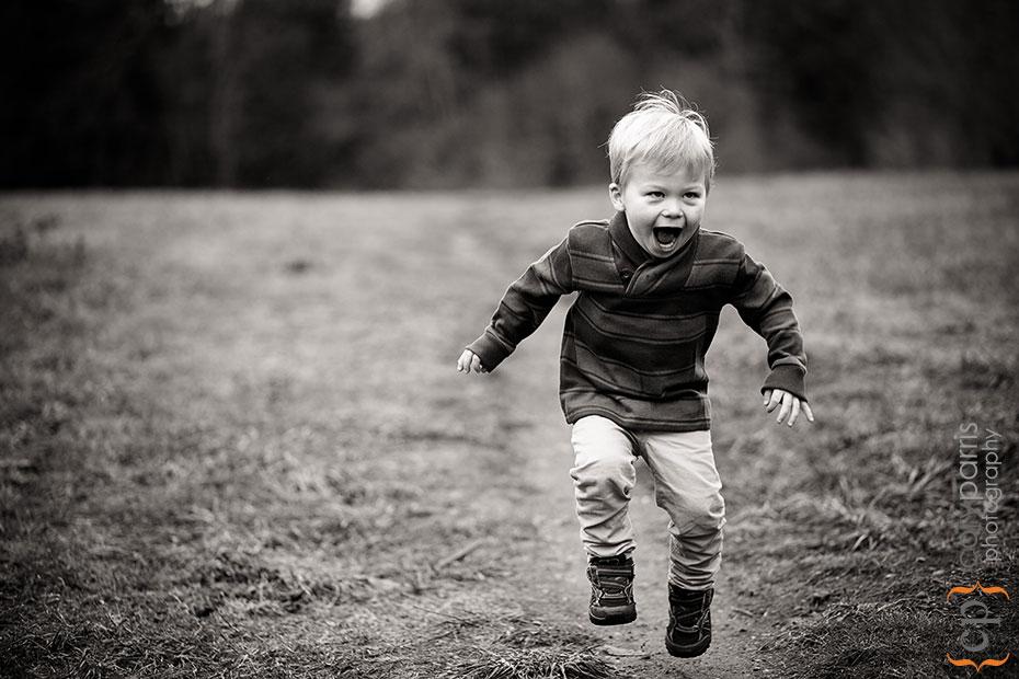 Jumping little boy portrait
