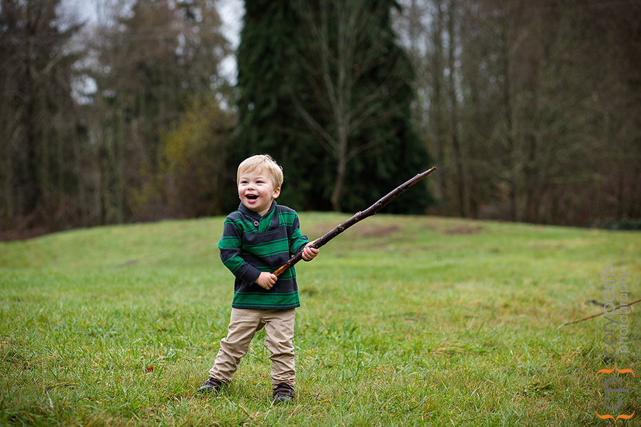 little boy with a stick