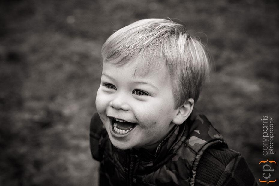 Little boy smiling in b&w