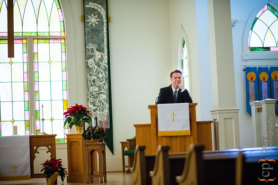 man standing at a pulpit