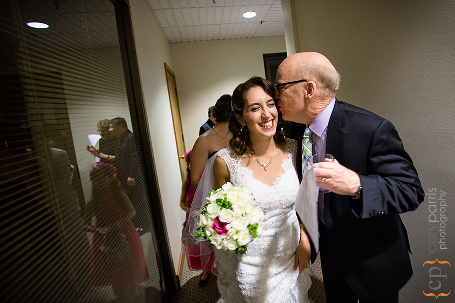 bride gets a kiss